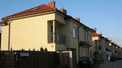Osiedle domków jednorodzinnych 8-segmentów 2008 kompleksowe pokrycie blachodachówką  warszawa  Wawer ul. Sęczkowa